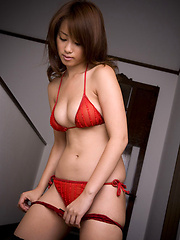 Lucious asian hottie with big titties in red lace lingerie