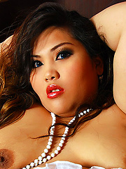 Asian BBW with stunning face and HUGE ass.