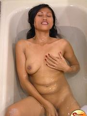 Sexy long-legged Filipina babe in the tub