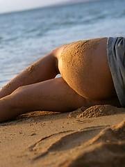 Nagisa is enjoying the sun and sand on the nude beach
