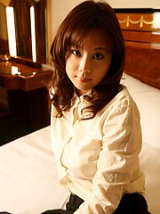 Misa poses showing big tits in her lingerie while on the bed