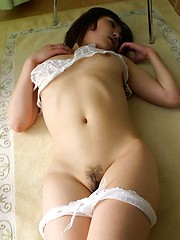 Horny Asian tramp is showing off her perfect ass in lace