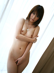 Horny Asian slut slowly shows off her pert titties and ass