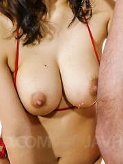 Kaede Niiyama shakes huge nude tits while sucking dicks outdoor
