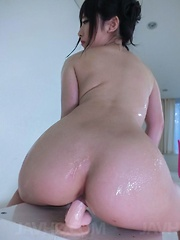 Arisa Nakano fondles cans while riding dildo with oiled cooter