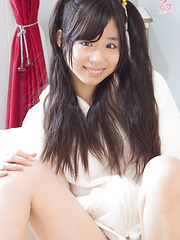 Skinny and flexible Japanese cutie Aiku-chan seduces us with her twintails and tight thong stretching