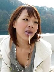 Arisa Araki has mouth full of cum after sucking dongs outdoor