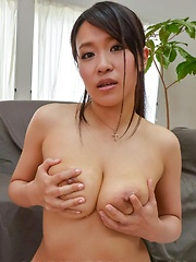 Saki Sudou licks her tits and gets sucked cocks between them