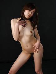Brown-haired asian girl takes two cocks
