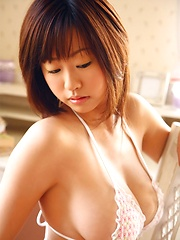 Kitamura Hitomi poaing her natural big tits with white lingerie.