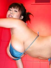 Japanese Fuko posing huge tits in red bikini
