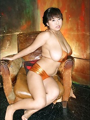 Fuko posing her moster tits in a black bikini