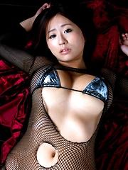Hitomi Kitamura posing her natural big tits in bikini