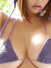 Very hot busty japanese Hitomi Kitamura posing in purple bikini