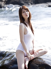 Skiny and sexy model Emi Kobayashi posing in several outfits