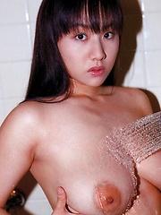 Ayami Sakurai posing her natural tits