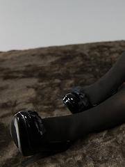 Toudou Yukari posing in black and white stockings