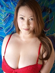 Busty Asian babe posing in red lingerie
