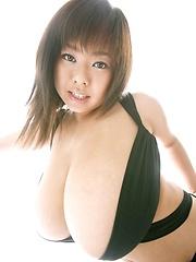 Sexy Fuko posing in a black bikini her monster tits