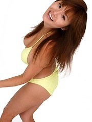 Av idol Yoko Matsugane posing in yellow bikini