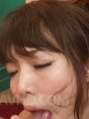Megumi Shino Asian gets cum from sucking two dongs with talent