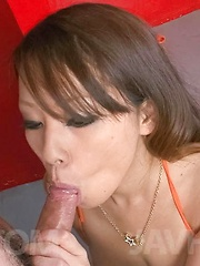 Asuka Asian sucks shlong and takes it between her generous boobs