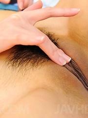 Akari Asagiri Asian rubs her clit while teasing cock with soles
