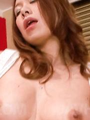 Miharu Kai Asian licks banana, rubs her pussy and fondles boobs