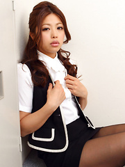 Asuna Kawai Asian shows sexy legs and big assets in office suit