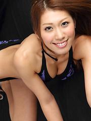 Reika Miki Asian smiles while exposing sexy curves im lingerie