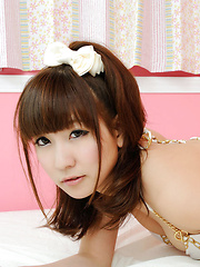 Chihiro Akiha Asian sits with hot bum up in the air in her bed