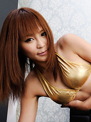 Sayuri Ono Asian in golden lingerie exposes her long sexy legs