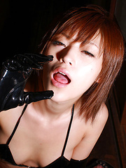 Azusa Itagaki Asian in fishnet stockings rubs her cunt of chair