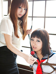 Dimdim Asian in uniform is tied in ropes by another sexy cupcake