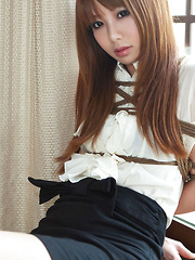 Dimdim Asian in school uniform is tied in ropes and can´t scream
