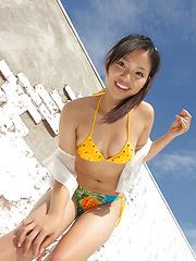 Shizuka Asian honey offers beautiful smile while posing outdoor