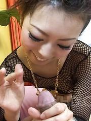 Yuki Asami Asian in fishnet strokes and rubs joystick with feet
