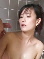 Manami Komukai Asian has orgasms and gives blowjob at shower