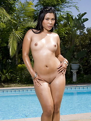 Kyanna showing all at the swimming pool of a Tropical resort