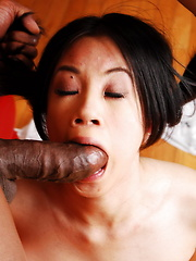 Young Asia got her tight pussy deeply fucked by a big black cock