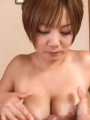 Meguru Kosaka Asian teases dick with hot tits and sucks it well