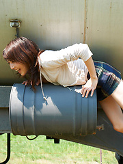Neo Asian babe in short skirt loves playing in dangerous places