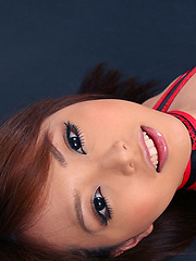 Momoka Narushima Asian in red and black latex poses on the floor
