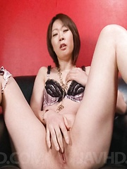 Rio Kagawa Asian rubs clit before fucking her pussy with vibrator