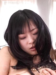 Nozomi Hatsuki Asian fucks slit with fingers and uses vibrator