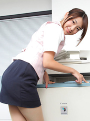 Naoho Ichihashi Asian in fancy outfit sits with ass on the office