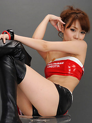 Ari Takada Asian in long boots is really playful at photo session