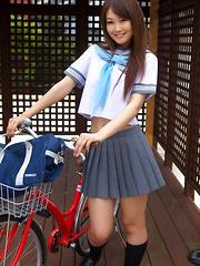 Misaki Nito Asian in school uniform goes to classes riding bike