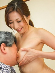 Mirei Yokoyama Asian undresses and gives man blowjob and footjob