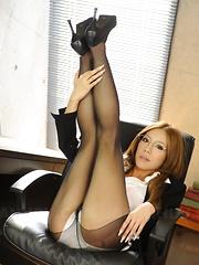 Ramu Nagatsuki poses in black nylon stockings